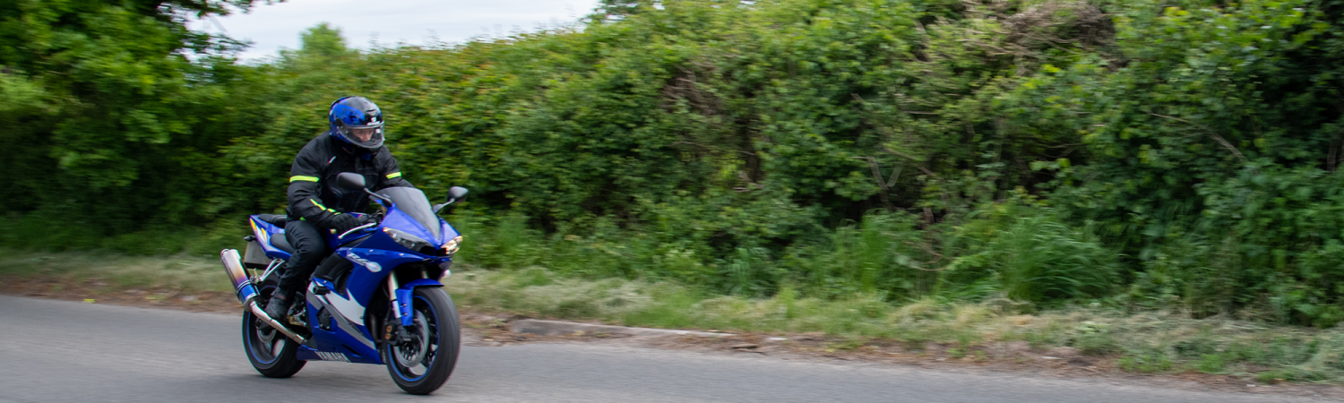 Biker on Country Road COming towards camera